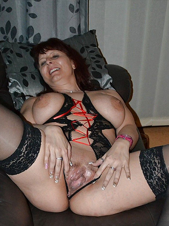 Busty German mature spreading for your cock
